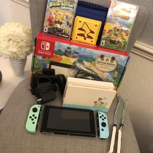 Nintendo switch animal crossing edition with the games and case BUNDLE for Sale in Haines City, FL