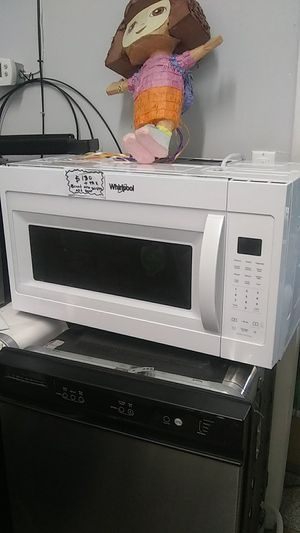 Whirlpool microwave oven brand new scratches and dents for Sale in Halethorpe, MD