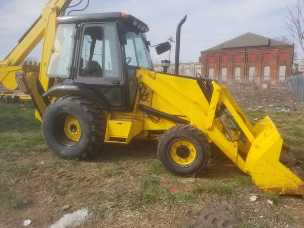 Case 580K backhoe 4x4 heated with extend a hoe and trailer