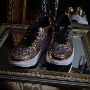 Rose gold walking shoes with curved sole for Sale in San Diego, CA
