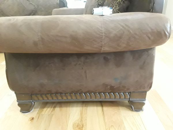 I am selling two Marco sofa finished with wood and reversible brown fabric.