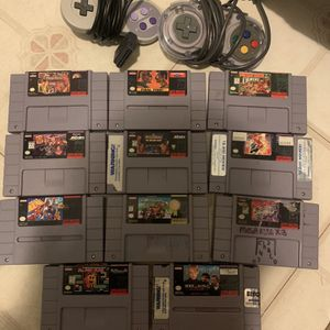 SNES Games and two controllers for Sale in Miami, FL