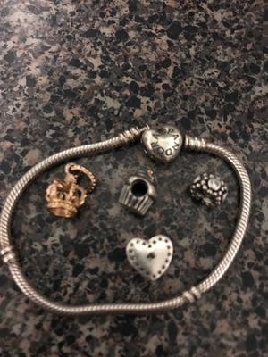 Pandora bracelet with 4 charms for Sale in Kenosha, WI