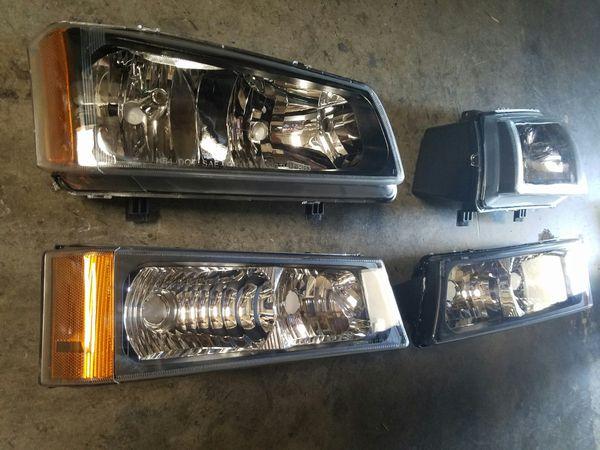 New 2003 to 2006 Chevy Silverado black housing headlights