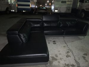 Modern leather sectional couch + ottoman for Sale in Fairburn, GA