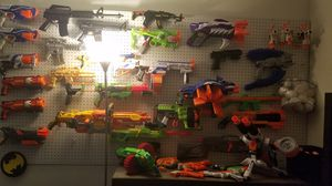 Wall full of nerf gun...and bucket of bullets for Sale in Port St. Lucie, FL