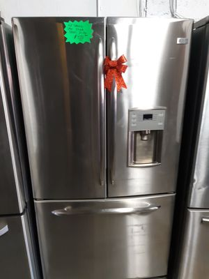 GE STAINLESS STEEL FRENCH DOORS FRIDGE WORKING PERFECTLY 4 MONTHS WARRANTY for Sale in Baltimore, MD