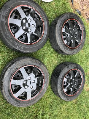 4 Rims and tires Nissan Altima 5 lug 215 60 15 Brand new Black hub caps for Sale in Freeport, NY