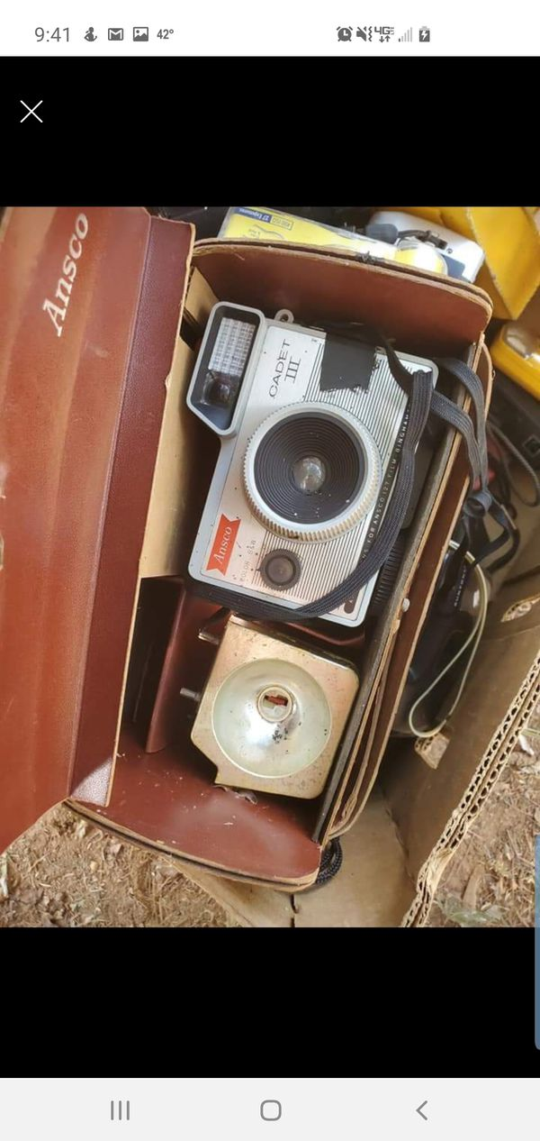 Box of old 35mm and digital cameras