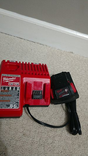 Milwaukee battery and charger for Sale in Sterling, VA