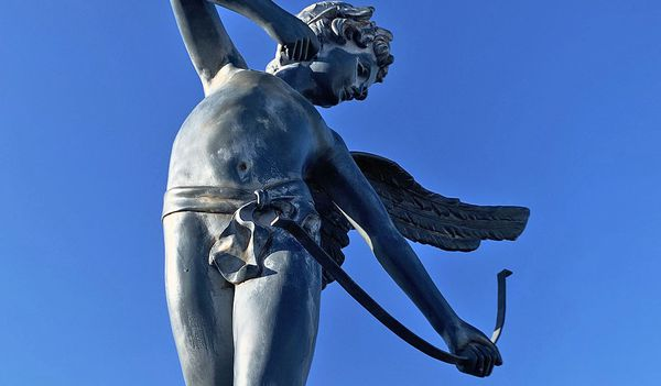 4.5 foot classic representation of winged cupid poised with a bow statue