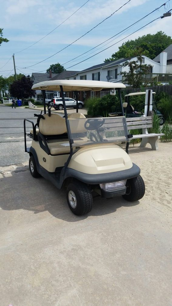 2005 Club Car with brand new batteries windshield lights back seat nice car