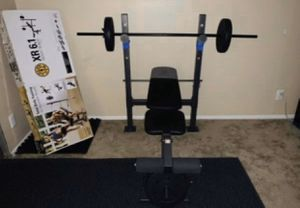 Gold Gym Bench and Bar set with weighted plates 100lbs(10s,15s,25s) for Sale in Pasadena, CA