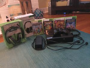 Good condition Xbox 360, Xbox 360 controller, 4 Xbox 360 games, and Turtle Beach Ear Forces XL1 wired headsets. for Sale in Orlando, FL