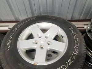 """17"""" Jeep Wrangler wheels with tires. for Sale in Heathrow, FL"""