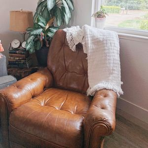 Vintage genuine leather chair with matching ottoman for Sale in Fresno, CA