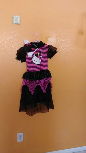 Halloween costume of Hello Kitty witch for a girl size small 4 to 6 it's in good condition it it also comes with a little witch hat for Sale in Los Angeles, CA