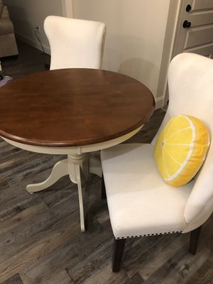 Round dining table with two wingback chairs for Sale in Wilson, NC