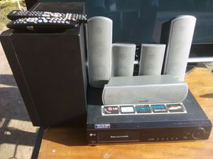 500 Watts LG surround sound receiver with built-in 5 discs DVD player with remote control plus speakers and subwoofer bundle for Sale in Washington, DC
