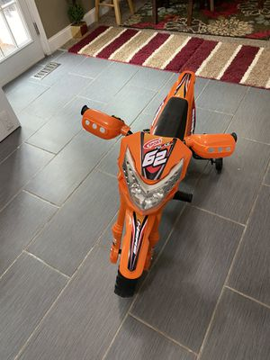 Kids Electric Battery Powered Ride-On Motorcycle Dirt Bike w/ Training Wheels for Sale in Richmond, VA
