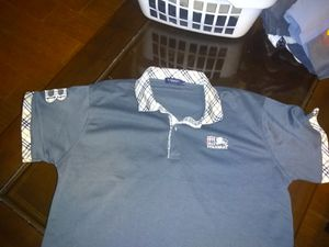 One Lacoste polo size large one Burberry T-shirt size large for Sale in Austin, TX