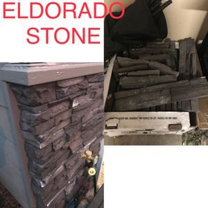 A box of Eldorado Stone Dark Rundle Stacked Stone for Sale in Kent, WA