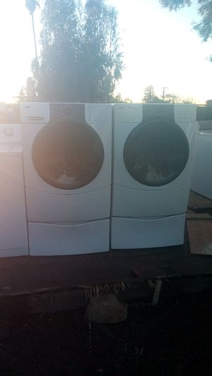 Kenmore elite h3t front load electric washer and dryer set work great for Sale in Fresno, CA