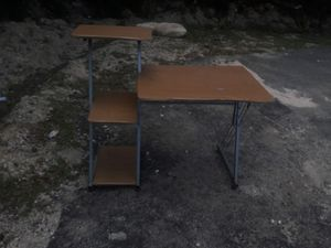 Nice desk / table shelving metal frame worst part is main top has a bubble but still goodd for Sale in Rockledge, FL