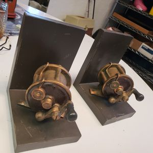 Two bookcase ends fishing reels for Sale in East Wenatchee, WA