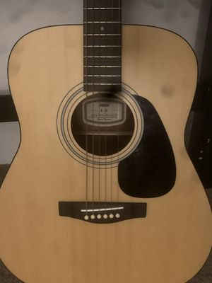 Guitar with extra strings and case for Sale in Eugene, OR