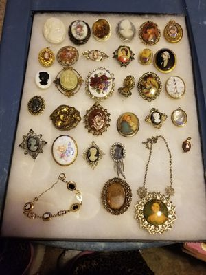 Vintage cameos 26 brooches1 bracelet 1 necklace 1pair of wearing 3 charms for Sale in Cayce, SC