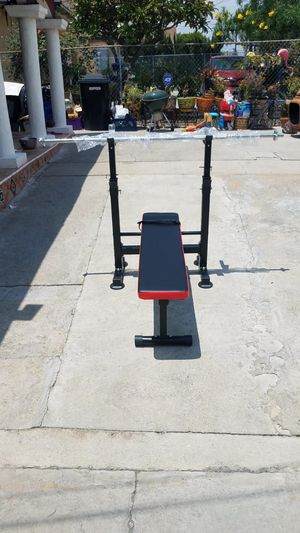 """Foldable Standard width bench press with 5 foot standard barbell 1"""" for Sale in Montebello, CA"""