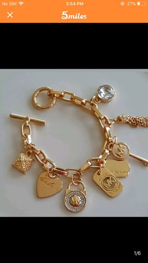 Mk Michael kors charm bracelet gold tone heart key padlock women's jewelry for Sale in Silver Spring, MD