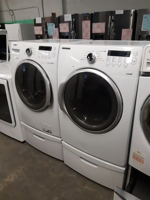 SAMSUNG FRONT LOAD WASHER AND DRYER SET WITH PEDESTAL WORKING PERFECTLY W/4 MONTHS WARRANTY for Sale in Baltimore, MD