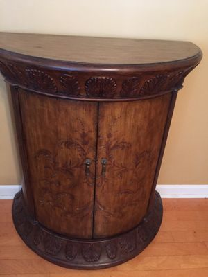 Wood half circle accent cabinet, ala Tommy Bahama style with carved palm style leaves and painted inlays for Sale in Lake Worth, FL