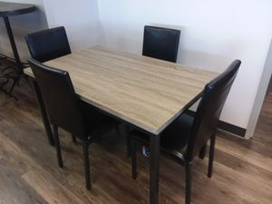 FAUX MARBLE TOP DINING TABLE AND FOUR CHAIRS for Sale in Plano, TX