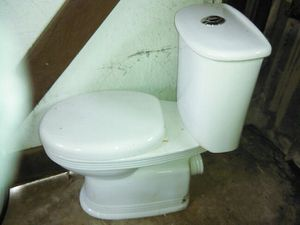 Toilet European top flush rear outlet complete with tank fittings. Costs over $300+ for Sale in Washington, DC