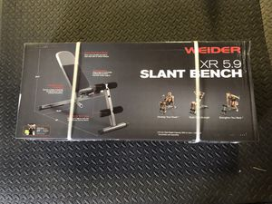 Adjustable Olympic utility workout bench brand new in box. Multiple adjusting back positions. Upright and flat as well. Leg supports for crunches as for Sale in Puyallup, WA