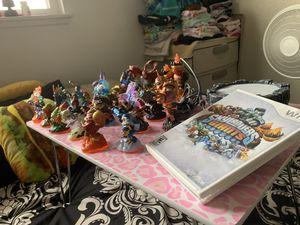 Skylanders action figures with a video game for Sale in El Cajon, CA
