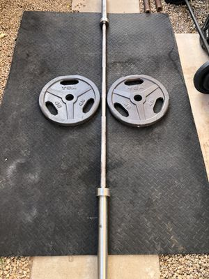 Weight plates and barbell.... 45 pound Olympic Bar ,with TWO 45 pound weight plates..$240 OBO for Sale in Glendale, AZ