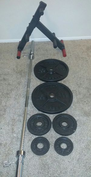 """Olympic 2"""" iron weights. 2x45lbs, 2x10lbs, 2x2.5lbs. 7 foot Olympic 45lb bar with 2 weight clips in great condition. 160lbs total including barbell. for Sale in Deerfield Beach, FL"""