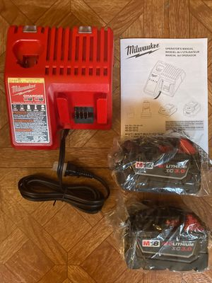 Milwaukee. M12/M18 Lithium Ion Multi-Voltage Charger and 2-piece XC 3.0Ah Battery Pack. for Sale in Brooklyn, NY