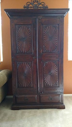 "Armoire dark wood with carved detail. 4 shelves inside. 2 drawers on bottom. H 73"" x D 22"" x W 44"" with 2 bottom drawers. Solid wood. for Sale in Gilbert, AZ"
