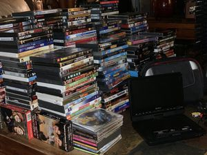 MOVIES ON DVD, 400+, portable player, Electric DVD tower for Sale in Miami, FL