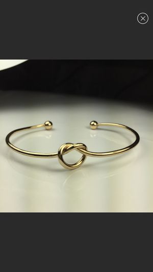 Gold tone love not infinity bracelet bangle women's jewelry accessory for Sale in Silver Spring, MD