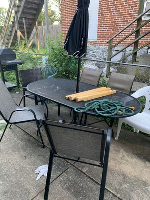Umbrella with table and chairs for Sale in York, PA
