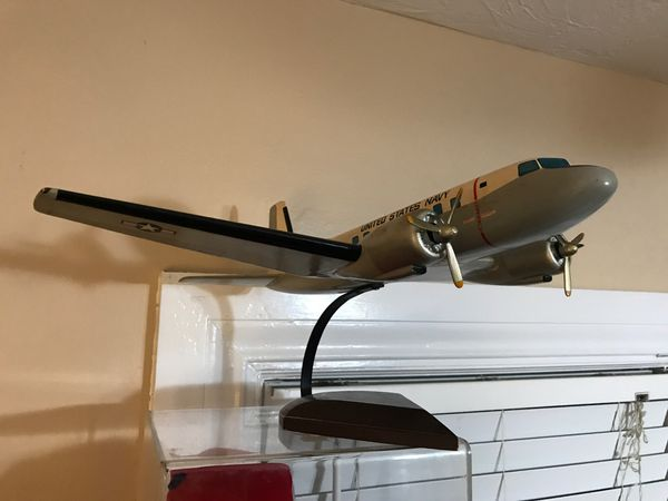 Vintage wood World War II Navy US airplane on stand