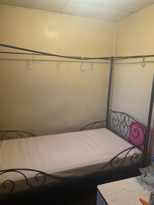 Twin canopy bed frame for Sale in Buffalo, NY