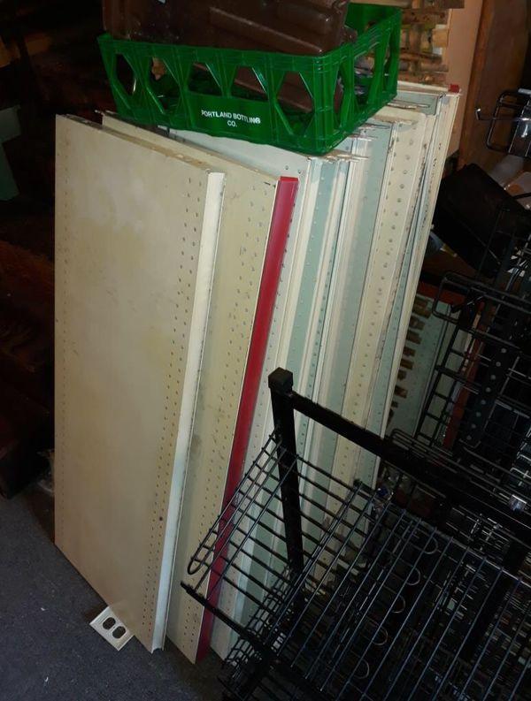 Lots of metal gondola shelves 4'x2'
