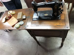 Antique sewing machine and cabinet for Sale in Modesto, CA